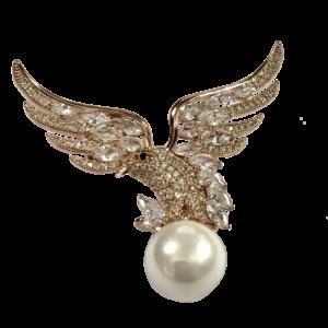 Broche aigle et cristaux navettes
